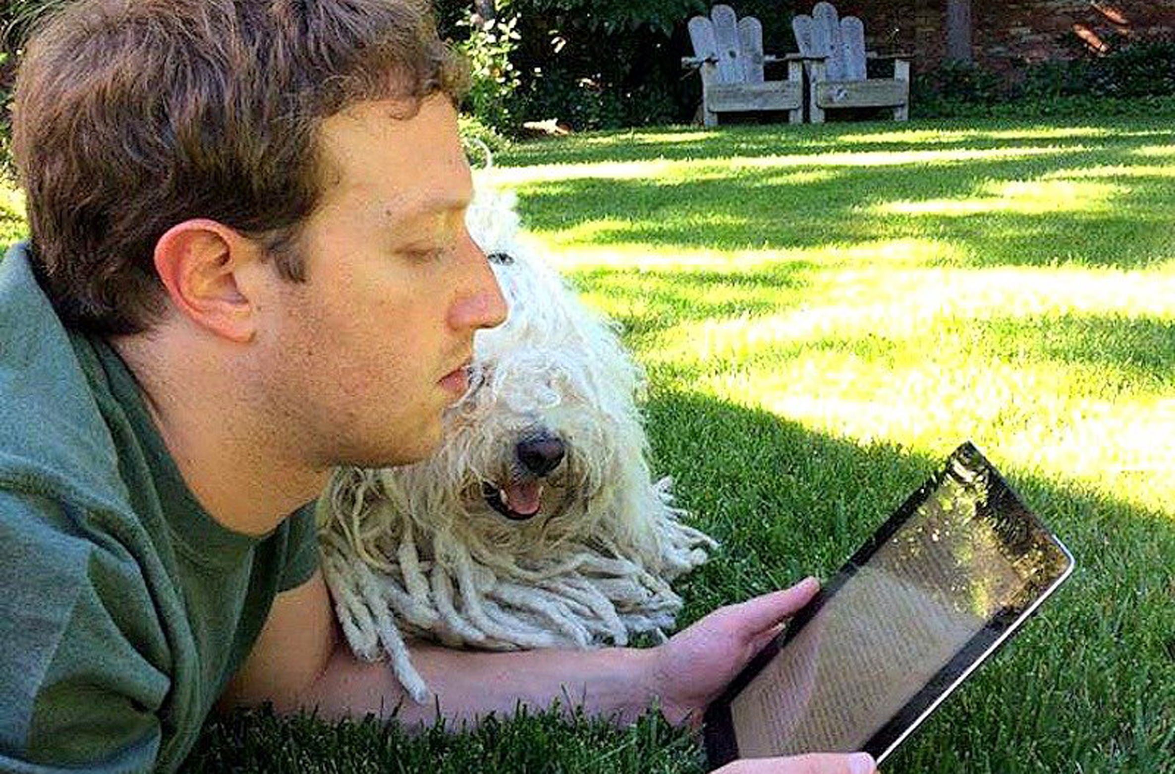 Zuckerberg Reading iPad